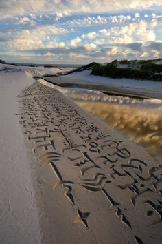 Beautiful calligraphy in the sands of Cape Town, South Africa, by the world's first beach calligrapher Andrew Van Der Merwe. l #calligraphy #landart #sandart