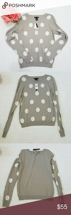 Grace Elements Polka-Dot Rhinestone Sweater Grace Elements Polka-Dot Rhinestone Sweater •Brand new with tags; never worn •This gorgeous sweater features polka dots on the front and around the sleeves. •Rhinestones decorate the polka dots to give the sweater a festive and glamorous look. •Crew neck, long sleeves •Stretchy materials  ••There are small holes on the left arm. Refer to picture #6  Measurements: Chest is: 18.5 inches Length is: 24.25 inches Hips are: 16.25 inches Waist is:  18…