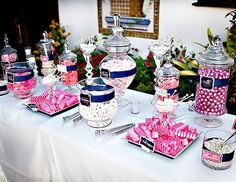 Favor idea: candy table.  Monochromatic candies, glass containers of different heights, to-go boxes.