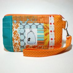 SOLD fish in a bag patchwork quilted wristlet, via Flickr.