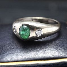 """14k wg, size 6.25, .62ct natural emerald cabochon, 2 x .09ct rbc ((about))The shape or style of this mounting evolved in the Gothic period and is known as a """"stirrup."""" Intended to evoke the shape of t"""