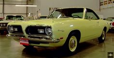 Gorgeous 1969 Plymouth Barracuda Mod Top muscle car: http://hot-cars.org/2015/05/07/sleek-red-1967-ford-mustang-fastback-s-code/