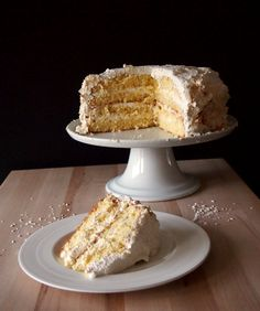 coconut cake; cake is a chiffon cake, nice and light, while still being super moist with a hint of richness; vanilla soaking syrup adds extra moisture and flavor to the cake; italian meringue buttercream incredible creamy, silky smooth texture and subtle sweetness are more than worth it; toasted coconut on the outside adds great texture and really brings home the coconut flavor