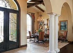 """like the doors only, but more elaborate metalworks don't like the columns at all - the interior looks """"mcmansion""""-y  105 Golden Bear - mediterranean - entry - austin - Vanguard Studio Inc."""