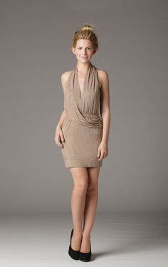 Definitely a dress for the flirt this halter dress shows off your sexy shoulders and is daringly backless. The short mini skirt length screams you are sexy and you know it. Model is wearing a size small.- $22.22