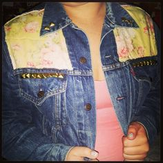 dark denim jacket with vintage yellow and pink floral machine sewn with gold studs along the front pockets $45