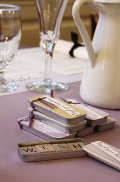 Scrabble tile fridge magnets as wedding favors...easy and cheap DIY potential.