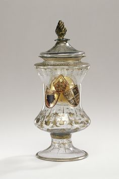 Covered Vessel; Unknown maker, Façon de Venise, possibly the Glashütte of Wolfgang Vitl (Austrian, active 1534 - 1540); Hall, Austria; about 1536 - 1540; Free-blown colorless (slightly purplish-gray) glass with applied decoration, gilding, and cold painted decoration.