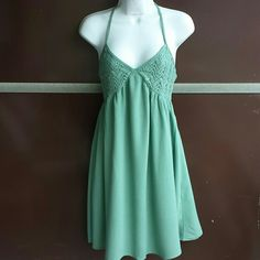 Solemio Los Angeles Dress Strappy green sun dress with lighter embroidery at the bust and a t-strap in the back. Great for summer days at the park. 100% Rayon. Solemio Los Angeles  Dresses