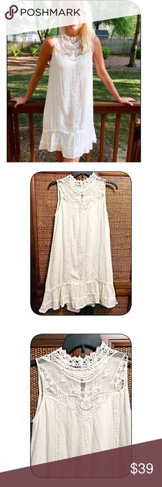 Stunning Ivory crochet fully lined dress! Elegance with a bohemian flair this beauty features a high cut crochet intricate detail top with a button top back- fully lined- lightweight with crochet detail in bodice and a ruffled hemline Dresses