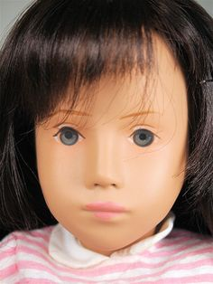 Close up of vinyl brunette Sasha doll, with wrist tag, wearing pink stripe dress, West Germany, by Götz. Sasha Doll, Stripe Dress, Pink Stripes, Friends Forever, Beautiful Dolls, Germany, England, Cute Dolls, Fringe Dress