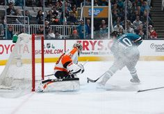 San Jose Sharks forward Andrew Desjardins kicks up a snow bath on his shot attempt (Dec. 2, 2014).