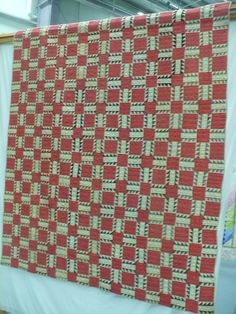 Any quilt with red attacts me but this one with all the petite hst's is superb.