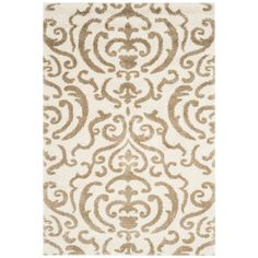 Safavieh Florida Shag Cream/Beige Rectangular Indoor Machine-Made Tropical Area Rug (Common: 10 x 14; Actual: 11-ft W x 15-ft L)