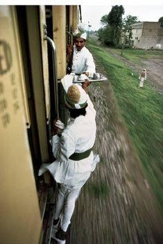 Chai Wallah's (Tea vendors) passing tea in a train; a sight from India.