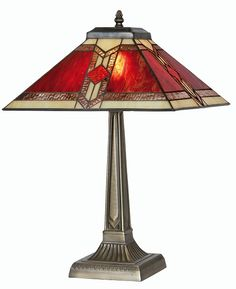 The Aztec has a rich autumn coloured Tiffany style design from which there is a small table lamp with a square Tiffany glass shade and antique finish square decorative base. The Aztec range is available from Luxury lighting.