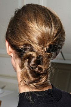 25 Haute Hairstyles That Rocked The Runway - backstage at The Row they opted to give models the former, with chic, slightly messy chignons that looked like the ultimate cool-girl hair accessory. We love this as a wedding hairstyle for a rad bride — it would look so amazing with a birdcage veil.    Photo: MCV Photo