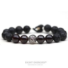 "The ""Peaceful Warrior"" helps to:    • Build inner strength  • Restore vitality and energy  • Feel grounded and empowered.  Made With Lava and Garnet Crystal Beads"