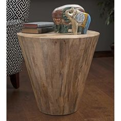 """In a unique inverted conical shape, the honey toned Fabiola accent table is made using a wood plank design. Product Description • Product Dimensions: 23"""" H x 24"""" W x 24"""" D • Product Re-Shipper Dimensi"""