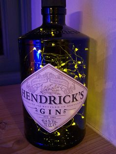 Led lighting Centerpieces - Hendrick& Gin bottle lights & in a bottle A unique and quirky gift in accent lighting for gin lovers. Lighted Centerpieces, Bottle Centerpieces, Wedding Table Decorations, Wedding Centerpieces, Hendricks Gin Bottle Ideas, Gin Gifts, Gin Bar, Gin Bottles, Bricolage