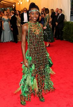 Risk taker! Lupita Nyong'o wears a netted green Prada dress to the 2014 Met Gala
