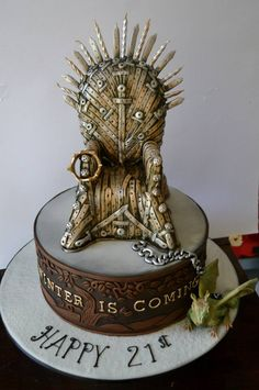 Game of Thrones, The Iron Throne cake by Sweet Ruby Cakes.  There's a dragon chained to the throne! I love all the details in the throne too. Very well executed. ~Lulladies