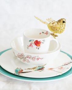 Bird Chirp place setting by Simply Fine Lenox from Gamble's Gift Gallery  Gold bird from PaperWorld    Photo by Amy Pennington as seen in417 Bride Summer 2009