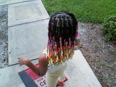 beads (simple braids in front and little ponytails in back)  May try box plats in back instead of ponytails