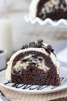 This Oreo Chocolate Cheesecake Cake is a chocolately bundt cake with an Oreo cheesecake filling and it's topped with a cream cheese glaze and more Oreos. PIN it for later When it comes to cake, I consider myself to be have some pretty high standards. This cake just couldn't wait to be center stage. I …