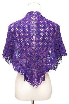Haruni is a triangular shawl, worked from the top down, and ends with a looped bind off worked with knitting needles - free pattern by Emily Ross