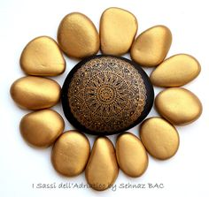 https://www.etsy.com/listing/264112221/hand-painted-stone-mandala?ref=listing-shop-header-2