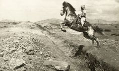 A young North American girl jumps her horse over a ditch in Mexico, May 1914.Photograph by Shirley C. Hulse, National Geographic