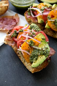 Crispy Prosciutto and Avocado Salad Toasts with heirloom tomatoes and cilantro -- an incredible combo of #flavor and color!