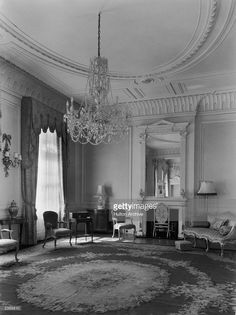 The drawing room on the first floor of Clarence House in London, 1949. The house was built in 1825-27 by John Nash for the Duke of Clarence, later King William IV. Two 18th century gilt armchairs and a sofa, all by John Linnell can by seen beside the original fireplace.