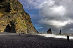 Reynisdrangar, three black basalt columns protrude from the North Atlantic | Outside Vik, Iceland