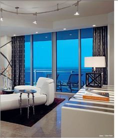 A stylish modern living room designed to welcome friends and family with an inviting elegant feel. Modern Decor, Mid-century Modern, Modern Table, Contemporary, Modern Living, Interior Design Usa, Lamp Inspiration, Florida Design, Living Room Designs