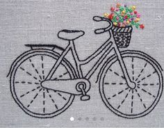 Embroidered bike with a basket of flowers