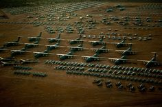 """A fleet of C-5 Galaxies tower above the rest of the fighter and cargo aircraft inside the """"Boneyard"""" of the 309th Aerospace Maintenance and Regeneration Group at Davis-Monthan Air Force Base, Ariz. (Credits: U.S. Air Force photo/Tech. Sgt. Bennie J. Davis III)"""