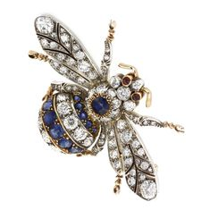 A SAPPHIRE AND DIAMOND BEE BROOCH - Bentley & Skinner