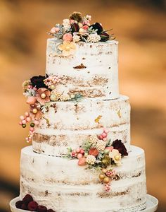 I always hate how much frosting there is on wedding cakes…I love how this one looks rustic like a birch tree!