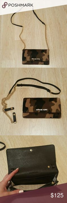 MichaelKors JetSet Camo Calf Hair Wallet w/ Chain Authentic Michael Kors beautiful camo Jet Set wallet with chain! Can be worn cross body or you can unbutton chain to use just as a wallet. Love this so much!! The camo is so cute and the calf skin is extremely unique and beautiful! I've gotten so many comments on it. The chain is brand new never been used and the wallet has been used a handful of times. The only scuff on it is in picture #5 but it is not noticeable and this item has so much…