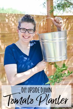 Grow tomatoes in a small garden with this DIY Upside Down Tomato Planter. I use a Galvanized Bucket to create a practical (and cute) hanging tomato planter. Growing Tomato Plants, Tomato Seedlings, Growing Tomatoes, Types Of Tomatoes, Varieties Of Tomatoes, Green Tomatoes, Baby Tomatoes, Cherry Tomatoes, Container Gardening