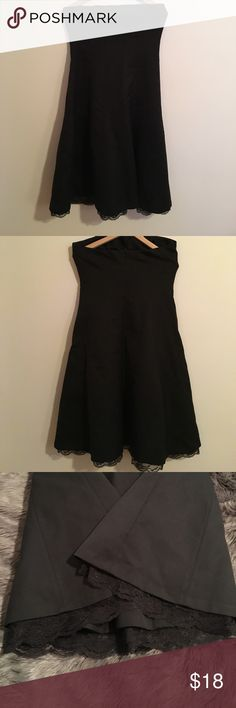 Strapless Express Dress Size 10 ❌❌WEEKEND SALE❌❌Very Cute Strapless Black Dress with Lace at the bottom. Size 10 Great Condition Shell:65%Wool 35%Polyester Lining:100%Acetate Mesh Lining:100%Nylon exclusive of trims Express Dresses Strapless