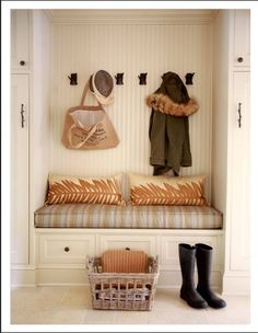 I'd love to demo my hall closet and just make this instead! Definitely more stylish and organized
