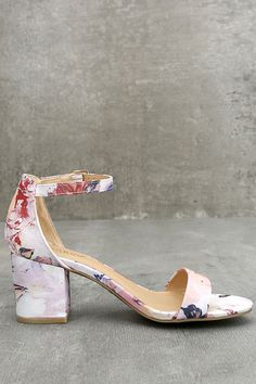 We are getting major vacation vibes from the Ft. Lauderdale Blush Multi Ankle Strap Heels! A blush pink, yellow, and navy blue floral print covers these peep-toe, single sole heels. A toe strap and structured heel cup, with adjustable ankle strap (and matching gold buckle) complete the look.