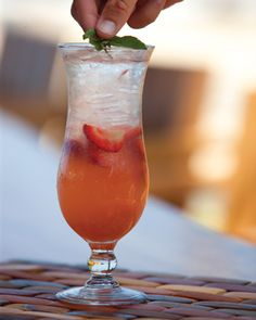 Tom's Pink Shirt Recipe from Beach Tree at The Four Seasons Resort Hualalai:       1.5 oz.        Tanqueray Rangpur Gin,  0.75 oz.      Orchid Guava Liqueur,  1.5 oz.        Lime Juice-Agave Nectar,  3                 Sliced strawberries,  Fill-up with lemon-lime soda (7 Up or Sprite)