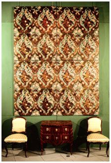 In the early 18th century the gilt leather patterns became almost symmetrical, a change due largely to the influence of the architect French Huguenot Refugee Daniel Marot (1661-1752). In the second third of this century textile designs influenced gilt leather strongly. In fact, not only their designs were copied, but also the forms