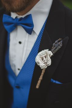 Each Groomsman had a paper flower hand made by me. The flowers were pages from books and poetry that I grew up with and really impacted me. Paired with lavender (to match the girls) and wrapped together with twine
