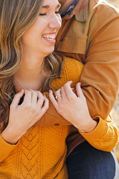 Fall Engagement Session - Man - Woman - Engaged - Couple - Fiancé - Outdoor - Wedding Ring - Diamond Ring - Ring Shot - Brown - Gold - Orange - Sweater - Jacket - Jeans - Montana Wedding Photographer - Sara Nagel Photography