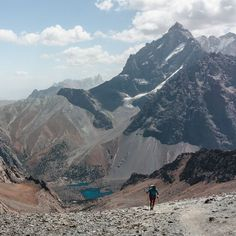 A hiker reaches Alauddin Pass in the Fann Mountains #Tajikistan #TravelPhotography @goingthewholehogg